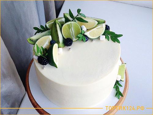 Белый бисквитный торт с фруктами на свадьбу